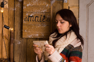 Woman examining letters from the mail box