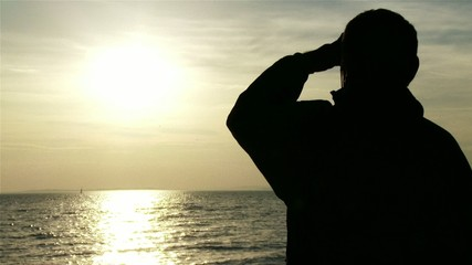 Mature Man in the Sunset Silhouette at Lake