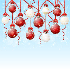 Hanging Christmas balls on snowy background