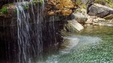 Small waterfall with clear spring water in Maligne canyon poster