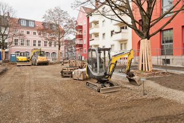 Strassenbau - Aufbringen und Verteilen der Schottertragschicht