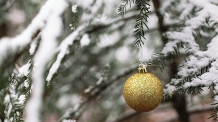 Christmas tree in snow and yellow globe