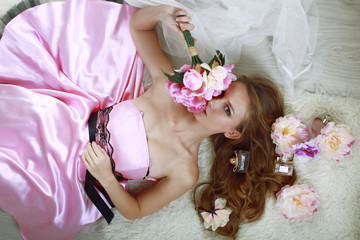Girl in pink dress with bouquet of flowers