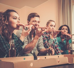 Group of young multi-ethnic celebrating in home interior