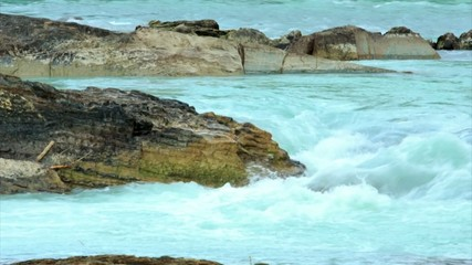 Turquoise water stream. RAW video