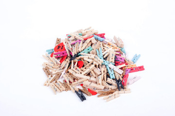 Colorful wood pegs pins on white background