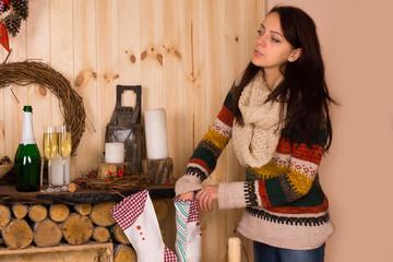 Woman Reaching into Christmas Stocking
