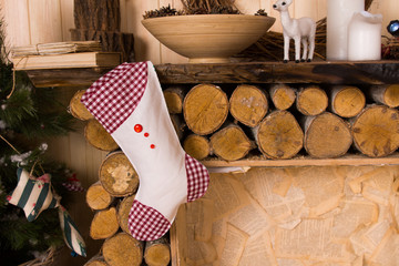 Christmas Stocking Hanging from Rustic Mantle