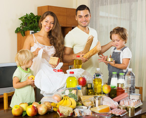 Cheerful family with bags of food