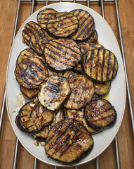 Italy, food, grilled eggplants on a wooden table