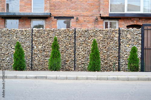 Foto op Canvas Wand Gabion mesh wire fencing