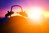 alarmclock silhouette at sunrise cityscape