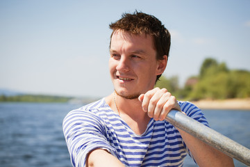 young man rows the boat