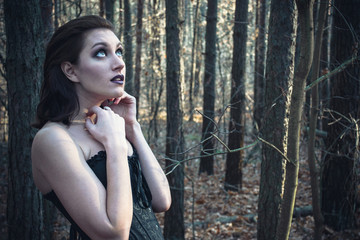 Young goth woman in a autumn forest