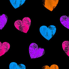 Seamless pattern with colorful hearts over black background.
