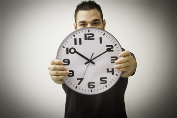 young man with clock
