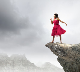 Woman on rock edge