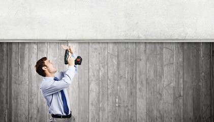 Businessman with drill