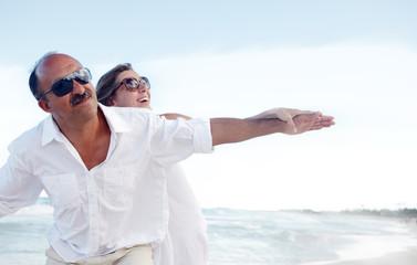 Happy couple on caribbean beach.