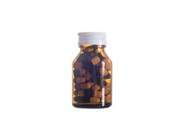pill in glass bottle