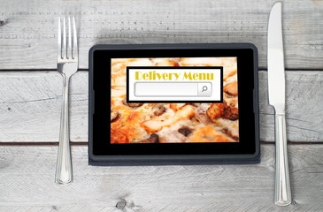 On-line and Internet food delivery concept with a digital tablet