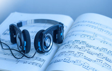 Headphones on sheet of music scores