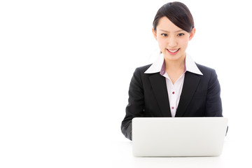 asian businesswoman using laptop on white background