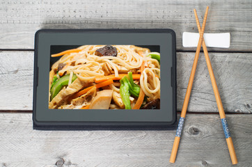 On-line and web asian food ordering concept with digital table a
