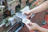 Worker at manufacture workshop operating cidan folding machine - 73640367