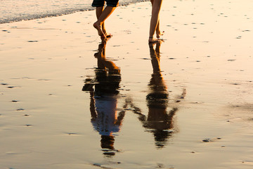 Romantic couple walking at sunset