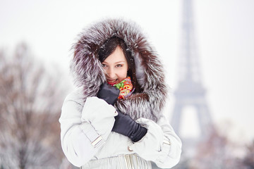 Girl enjoying rare snowy winter day in Paris