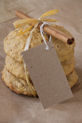 Oatmeal cinnamon cookie with bow and tag