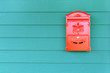 canvas print picture - Red mailbox with green wood background