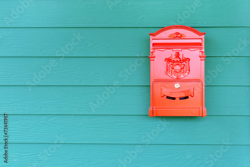 canvas print picture Red mailbox with green wood background