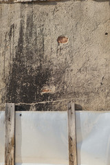 Old plastered wall with metal fance