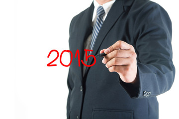 Businessman hand drawing 2015 happy new year on a whiteboard, is