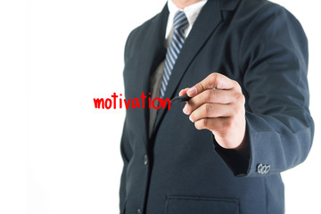 Businessman hand drawing motivation text in a whiteboard