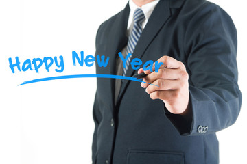 Businessman hand drawing happy new year on a whiteboard