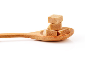 Cubes of cane sugar isolated on white background