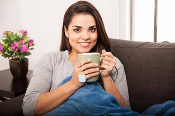 Happy girl drinking tea