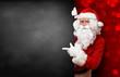 Leinwandbild Motiv Weihnachtsmann mit Tafel