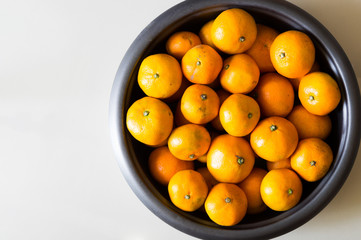 Group of oranges in big bowl