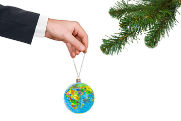 Hand with earth and Christmas tree
