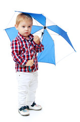 Little boy standing colored umbrella .
