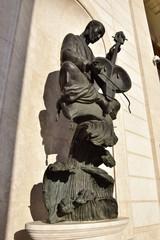 Sculpture featuring a musician playing a Kazakh instrument