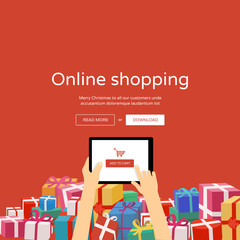 Online shopping - hands with tablet & christmas gifts