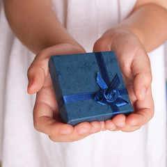 Kids hands holding a gift