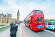 London. Double Decker bus speeding up on Westminster Bridge