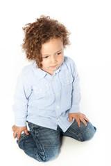 Cute Curly Blond Male Kid Kneeling Down