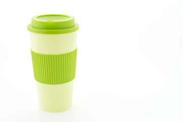 Green plastic coffee mug isolated on white background